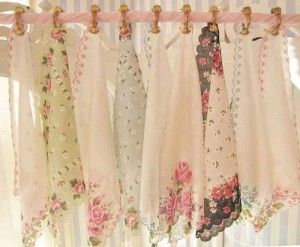 Maybe one of the sweetest ideas for a shabby chic window dressing ever - this lovely row of vintage hankys would look amazing at the top of a plain curtain, or used halfway down the window as a cafe style window dressing. So pretty!