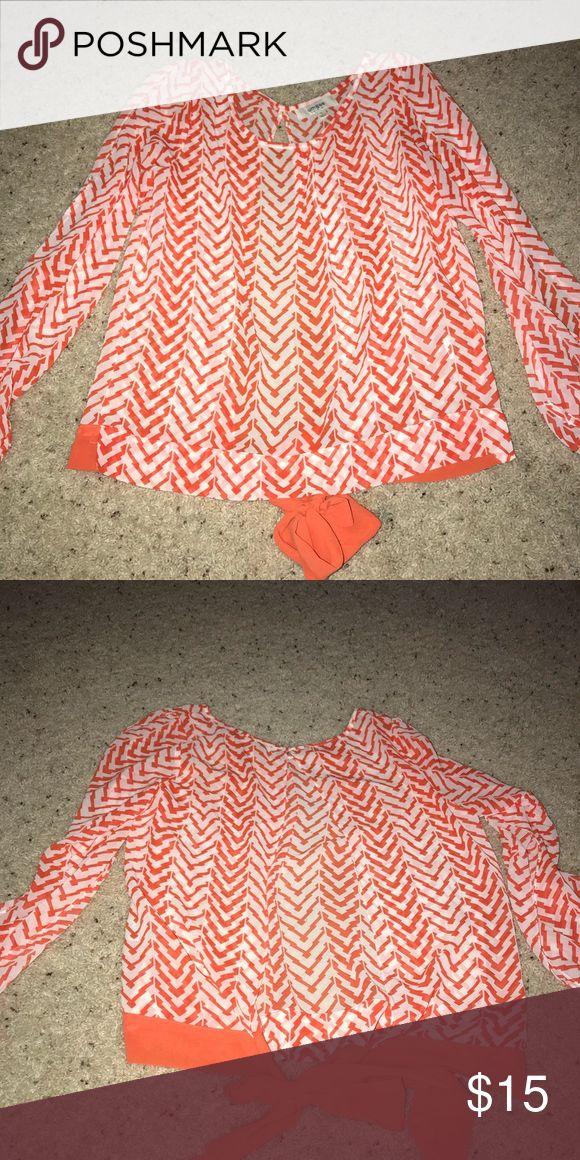 Orange and white chevron blouse Chiffon orange and white chevron blouse. Split back tie at bottom. Tops Blouses