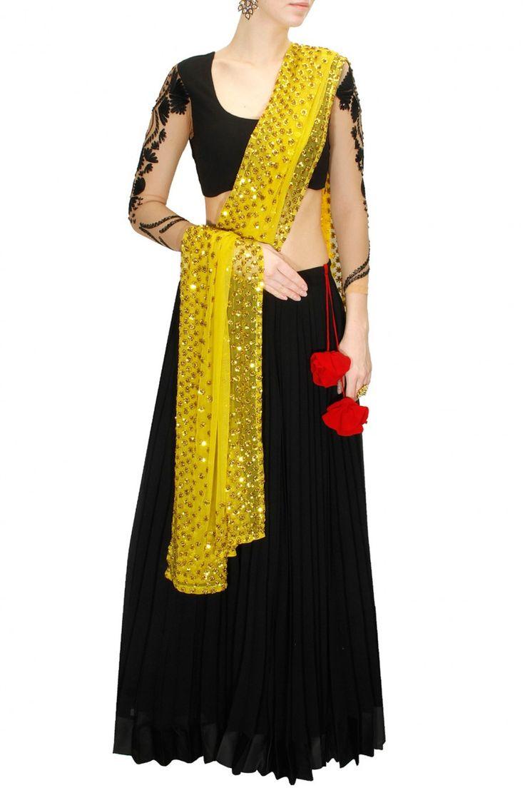 ASTHA NARANG Black and bright yellow embroidered lehenga set via perniaspopupshop.com