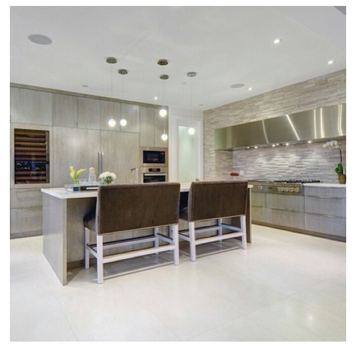 Sleek kitchen with bench bar stools 3485 Mathers Avenue, West Vancouver, British Columbia