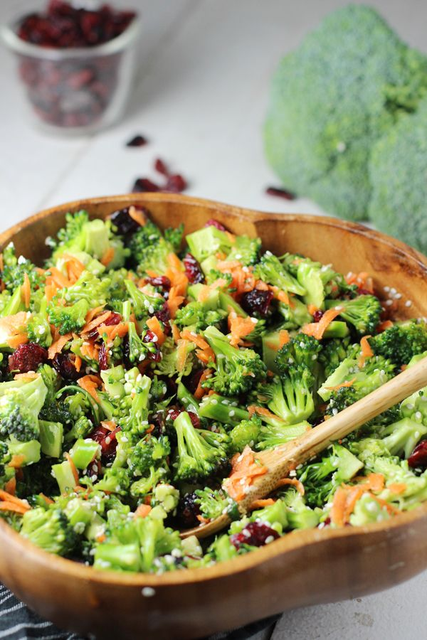Broccoli, sesame seeds, carrots, craisins, coconut aminos, honey, rice wine vinegar, garlic powder and ginger combine for a taste that perks up broccoli.