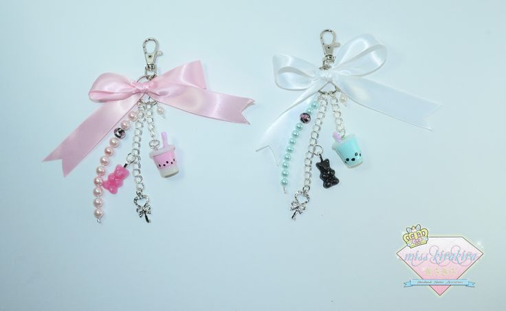 """Accessorize your handbag with this pretty Jamie charm keychain. This keychain has a lobster clasp so it's easy to attach to your handbag. This keychain measures 6.5"""" long.   This keychain comes with a silver chain attached with a resin gummy bear, polymer clay boba tea, faux pearls and bow."""