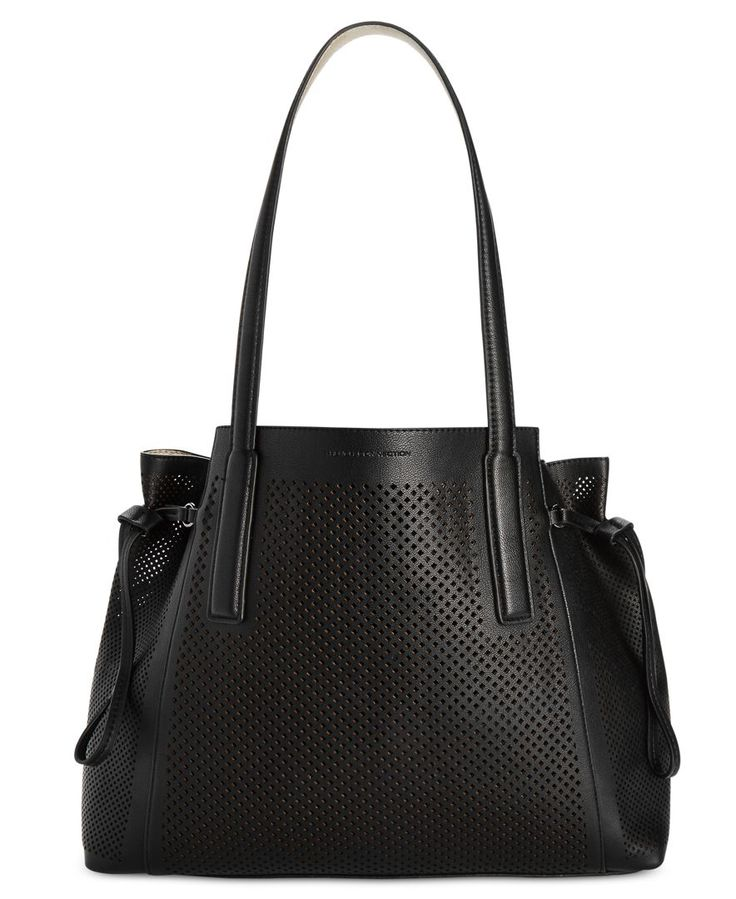 Styling is a cinch with this sleek and sophisticated tote featuring on-trend…