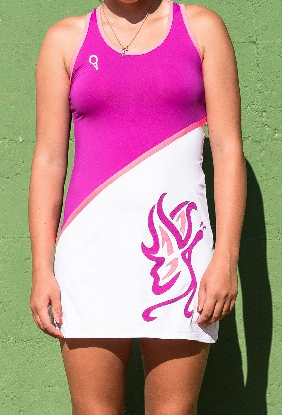 women's tennis dress with particular application on the side of a butterfly motif made with inserts of fabric of different colors