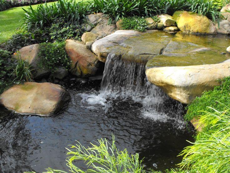 Koi Pond Design Ideas 55 visually striking pond design ideas for your backyard Rock Koi Pond Tropical Garden Waterfalls Santa Barbara