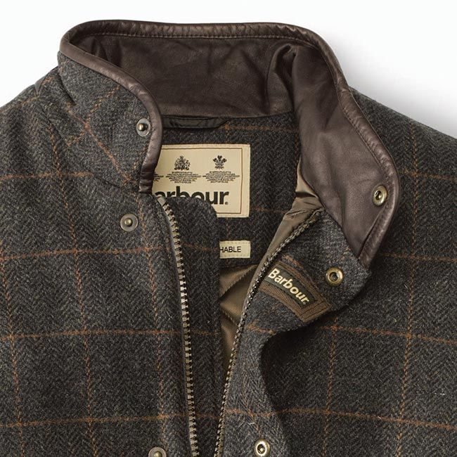 Crafted from a rich tweed wool with a traditional finish, this classic Prestbury jacket by Barbour® boasts a quilted waterproof lining for exceptional protection from the elements. Enhanced by a leather-lined stand collar and smart dual closure front with a zip and snap-close flap, it is as suitable for the stream and field as it is for an evening out. Angled, snap-close pockets. Rear adjustable side tabs. Quilted lining. A perfect pairing with a tattersall shirt and moleskins. Relax...