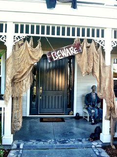 #halloweendecorating    Spooky Halloween Outdoor Décor.  I've seen a creepy entrance with black plastic garbage bags cut into strips but I think I like the burlap better!