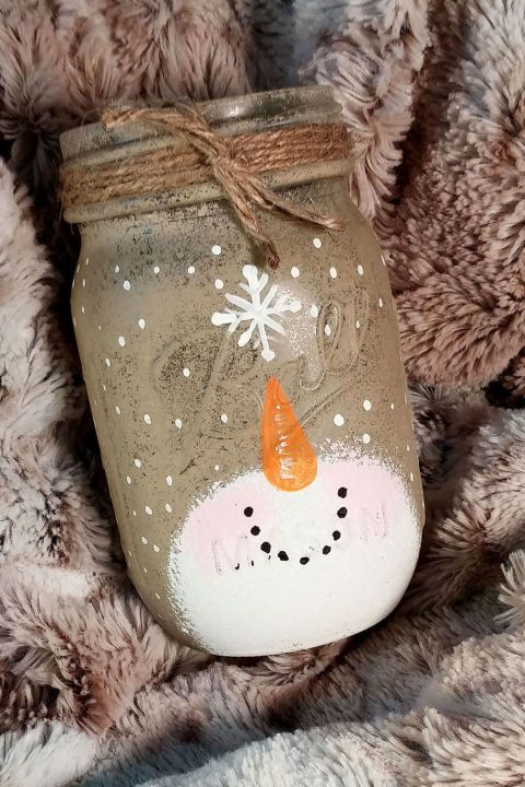 Available at NatalieLDesigns.Etsy.com, a few of these cute hand-painted Mason jars will look adorably rustic on your mantel.