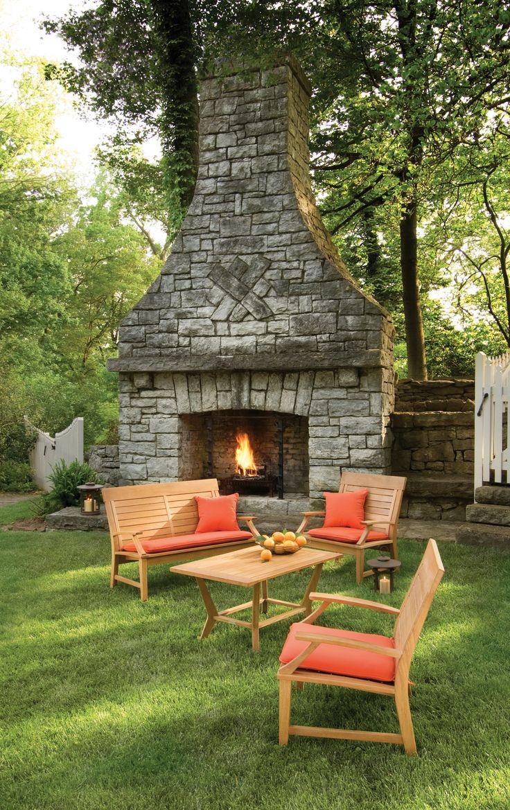 Fantastic yard! Love the fireplace and that teak furniture set... I'll take it all!