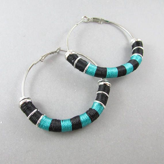 These lightweight wrapped hoop bold earrings are the perfect pair  to pop up with color to any casual or evening outfit.  Lightweight  Silver plated hoop diameter 1.9 in / 5 cms  Nylon thread in black and malachite   Made to Order : Delicate handcrafted design so please allow to 3-5 days