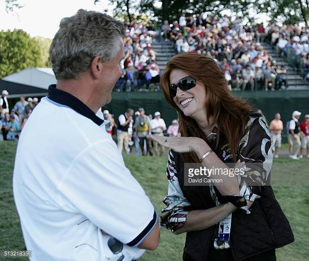 European team player Colin Montgomerie meets up with model and actress Angie Everhart during the afternoon foursome matches at the 35th Ryder Cup...
