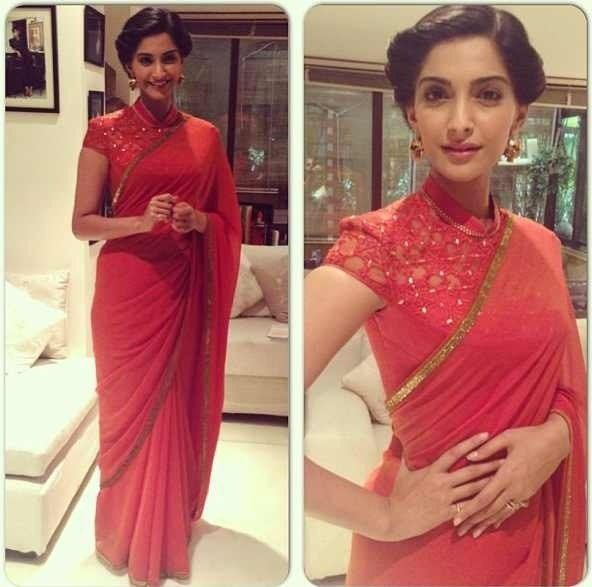 Sonam Kapoor I really like her drape-y red sari, super pretty even though I generally despise cap sleeves. That said, I could never wear this because of my kp :( maybe I could get a custom long sleeve blouse...ha! Look at me, talking about custom blouses :P