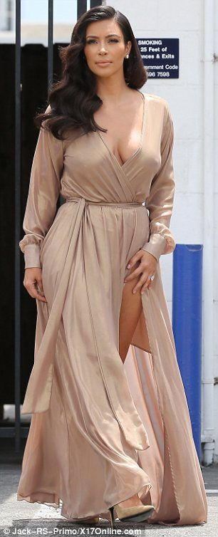 Feuding: Kim Kardashian (L) hit out at Adrienne Bailon for insulting her brother…