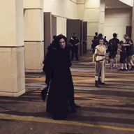 Oh! I saw this on starwars.com! There is a girl in the lightsaber costume and she got to meet both Mark Hamill and Hayden Christensen!!! Lucky girl! She also dress as Luke's other saber. All her own DIY. Very interesting story.<<<Maximum Fangirl