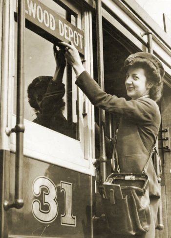 Conductress changing the destination sign on VR tram, St Kilda to Brighton route (1943). Photograph courtesy State Library Victoria.
