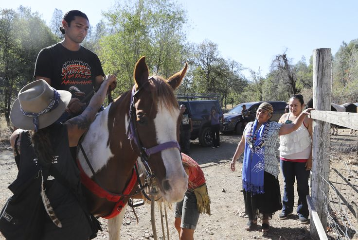 Winnemem Wintu Chief and Spiritual Leader, Caleen Sisk, second from right, watches her son, Michael Preston of Davis, as he... The Winnemem are nearing completion of their 300 -mile prayer journey from the Sacramento River Delta to the historical spawning grounds of the winter-run salmon on the McCloud River to raise awareness for salmon and water issues. Go to http://www.redding.com/news/local/riders-and-paddlers-raise-awareness-for-salmon-3d2fe26b-4a0d-2c17-e053-0100007f4e40-395196851.html