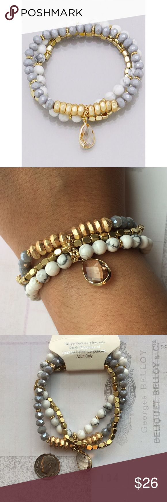 Multi Bead Stacked Stretch Bracelet Brand New Multi Bead Stacked Stretch Bracelet finished with a tear drop semi Precious stone. Nickel and lead free. One size fits most Boutique Jewelry Bracelets