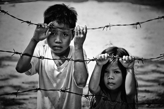 The barbed wire in this photo add the formal element of line. This picture also uses the rule of thirds as both of the faces are a third of the way vertical or horizontal