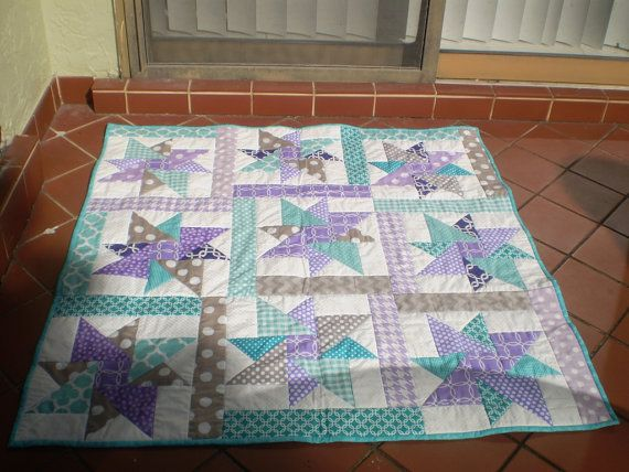 Baby quilt, handmade baby quilt, baby girl quilt, baby girl bedding, modern baby quilt, crib quilt, purple, teal, grey, Purple. Star sensation Sweet color combination just for the little girl it was created for! This terrific scrappy handmade patchwork quilt measuring 36 by 36 in purple, teal and grey featuring the traditional Hope in Hartford quilt blocks utilizing polka dots, links, circles and quatrefoil on a white background surrounded by scrappy frames and sashes, would be perfect as…