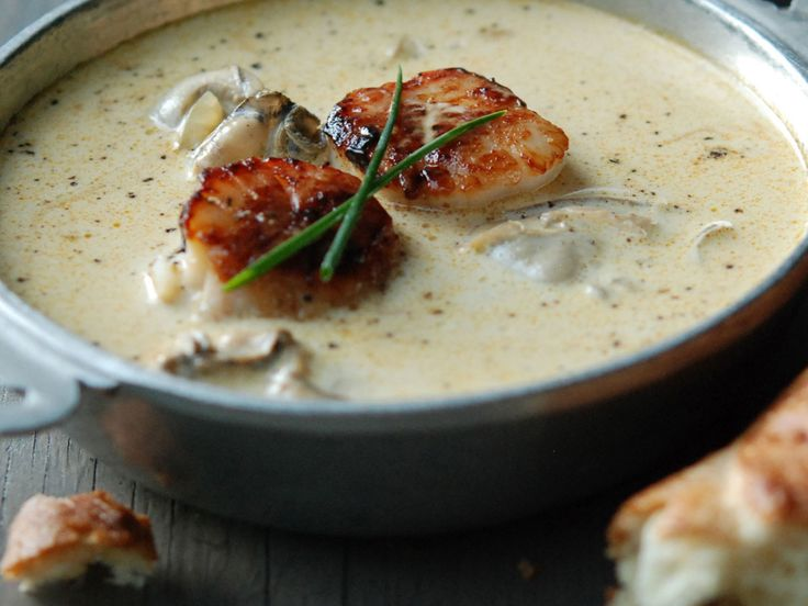 Montauk Scallop and Oyster Pan Roast | Andrew Zimmern's decadent, creamy stew is brimming with seafood. He punches up the rich broth with Old Bay and Worcestershire sauce.