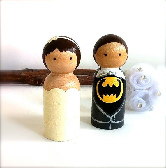 WEDDING CAKE TOPPERS  cute! Except my husband is going to be a million times better than Batman(;
