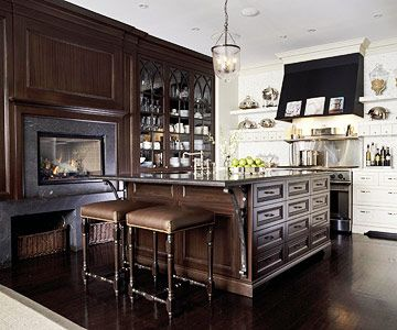 A gorgeous mix of dark wood and white in the kitchen. Also like carpet edge.