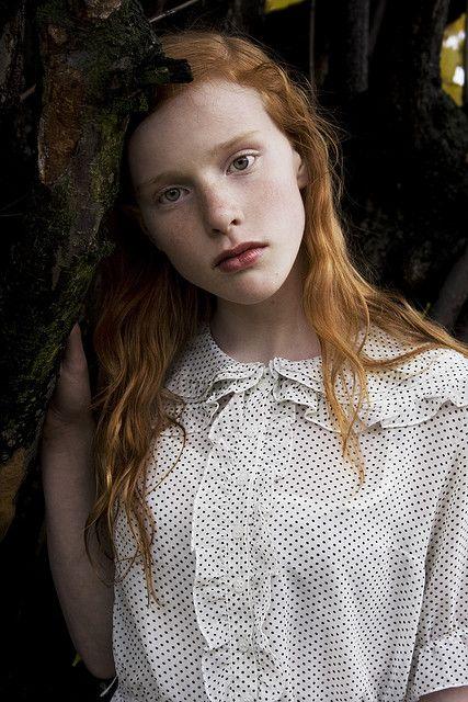 red hair and polka dots.