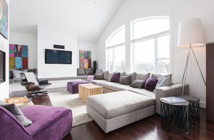 Living Room, Spacious Living Room With Stunning Pouffe Comfortable Velvet Sofa Amusing Ethnic Paintings Interesting Wall Mounted Plasma TV C...