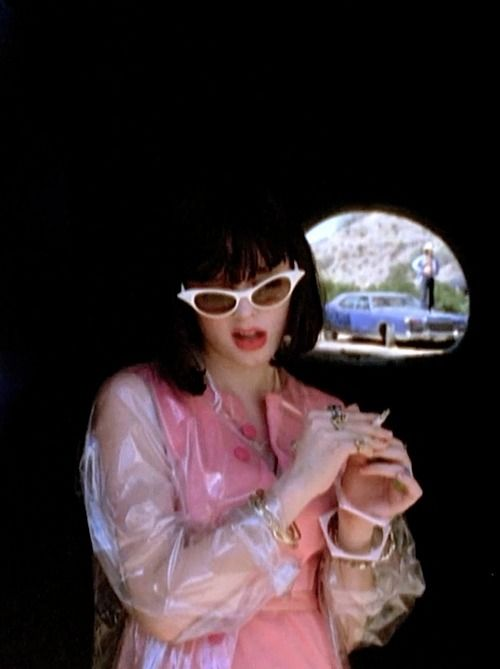 Rose McGowan in The Doom Generation (1995). The pink dress with the raincoat. Wish I had one