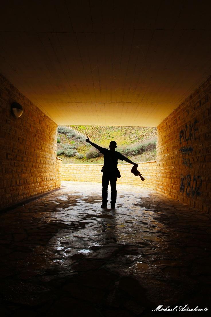 Dark tunnel with a man