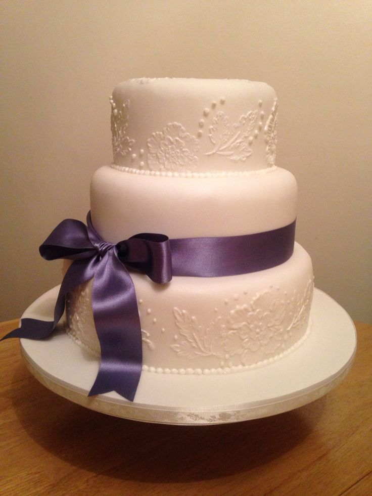 Wedding cake with brush embroidery bottom and top tier.