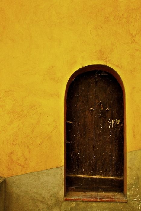 Wooden door surrounded by gold