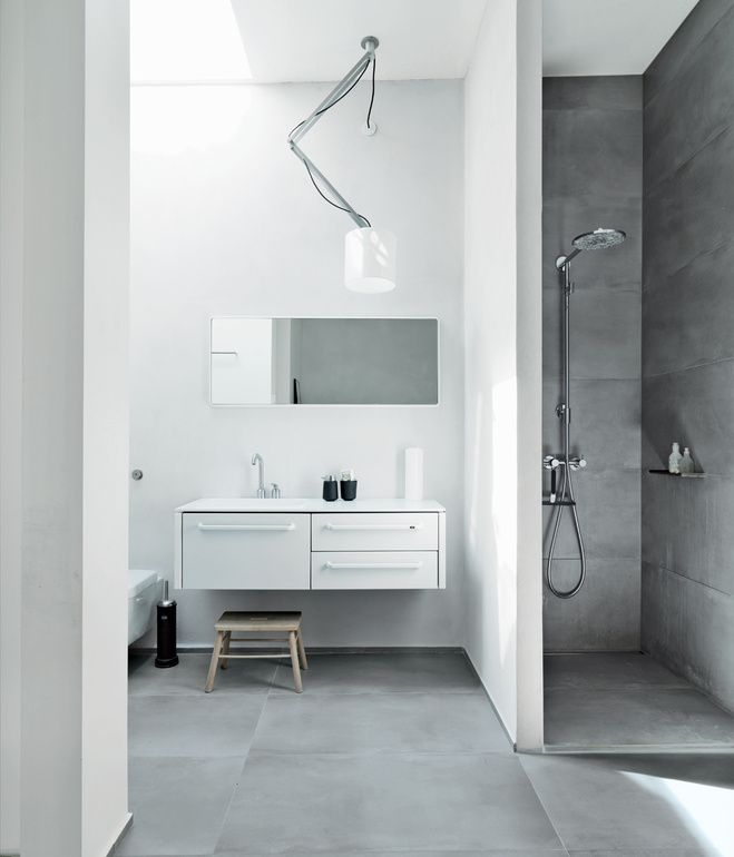 Morten Bo Jensen, chief designer at Vipp, outfitted the bathroom in his Copenhagen loft with outfitted his company's 982 bath furniture, ...