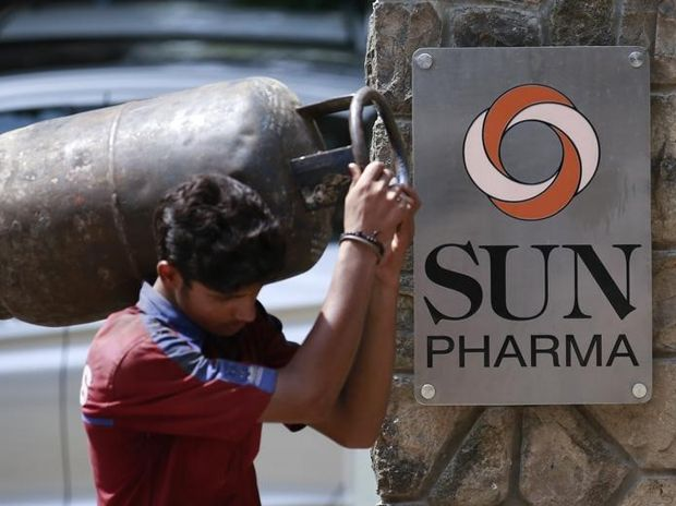 A man carrying a gas cylinder walks out of the research and development centre of Sun Pharmaceutical Industries in Mumbai. Photo: Reuters