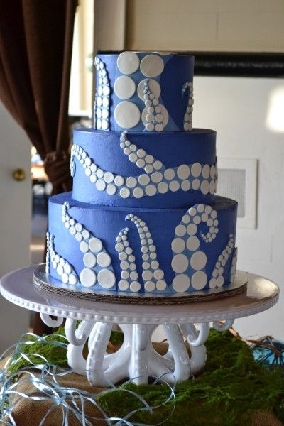 Inspiration for MJ's Birthday cake, he is always asking for a giant octopus battling a submarine and a squid....