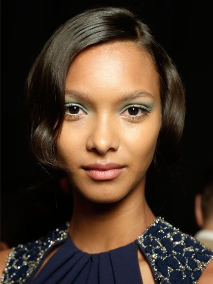 The glamorous '20s-inspired hair look from the spring 2014 Badgley Mischka show would feel perfectly at home on the red carpet. Here's how to get the look at home. | allure.com