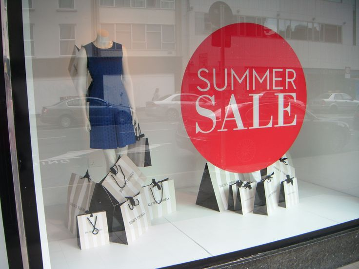Summer Sale Window Display featuring bags supplied by JJ O'Toole Ltd. We're proud to be the chosen packaging partner for Brown Thomas