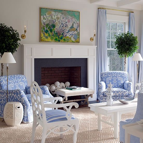 East Hampton - Meg Braff Interiors; like art above the mantel piece has 1 of the color blue that is in the rest of the room but not the rest of the colors.
