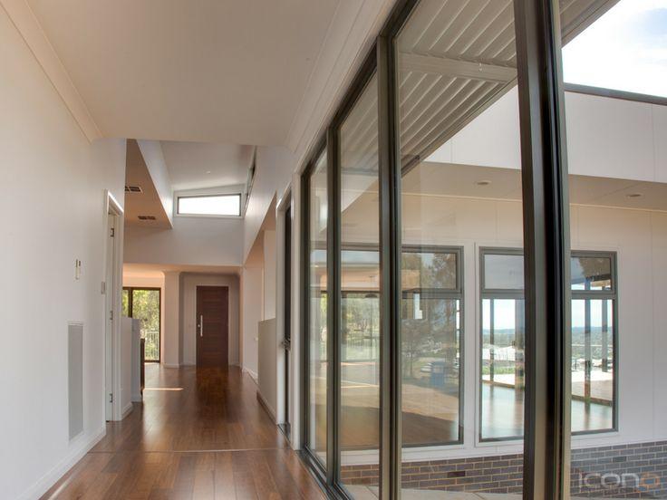 Love the big windows to let the natural light in. #livingroom #Australianhomes #floorboards #hallway