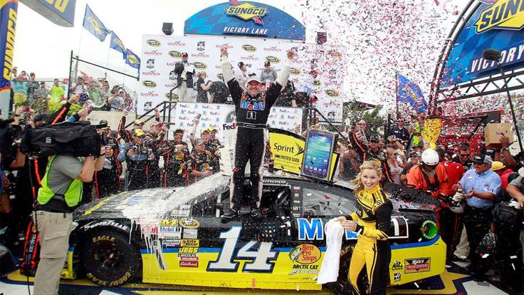 Tony Stewart celebrates in Victory Lane after winning the FedEx 400 benefiting Autism Speaks at Dover International Speedway on June 2, 2013.  This is Stewart's most recent NASCAR Sprint Cup Series victory.
