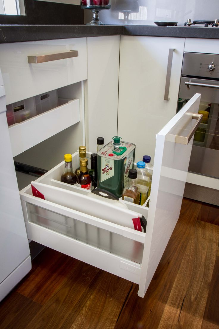 Oil drawer. Chipping board storage. Hidden spice drawer. www.thekitchendesigncentre.com.au