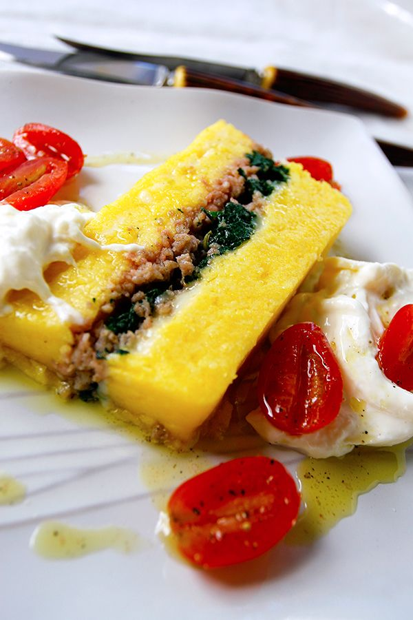 A savory terrine, or layered loaf, of polenta, spinach, an array of Italian meats and cheeses, including sausage, mortadella and pancetta. This recipe can be served as a hearty appetizer or a light meal.