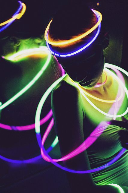 Give out glow sticks for everyone and have a small blacklight to make them glow noticeably