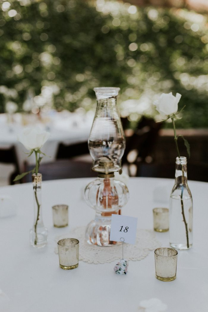 Oil lamp wedding centerpiece | Image by JC Guzman Photography
