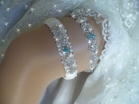 A personal favorite from my Etsy shop https://www.etsy.com/listing/193991878/aqua-blue-wedding-garter-set-something