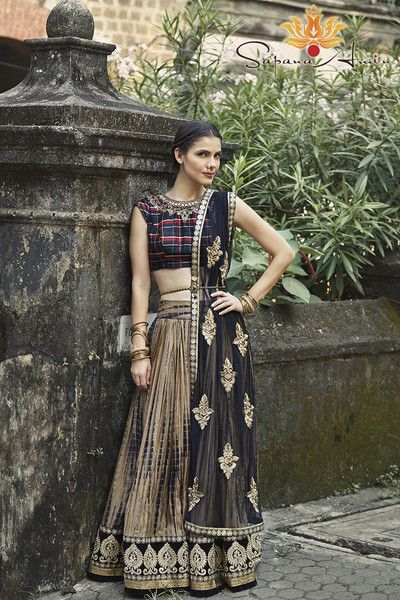Tartan blouse with hand embroidery, gold/black tie dye skirt with black soft net dupatta.