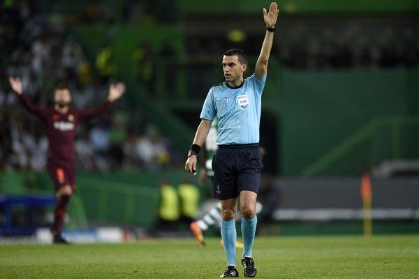 The referee Ovidiu Haţegan in action during the UEFA Champions League group D match between Sporting CP and FC Barcelona at Estadio Jose Alvalade on September 27, 2017 in Lisbon, Portugal.