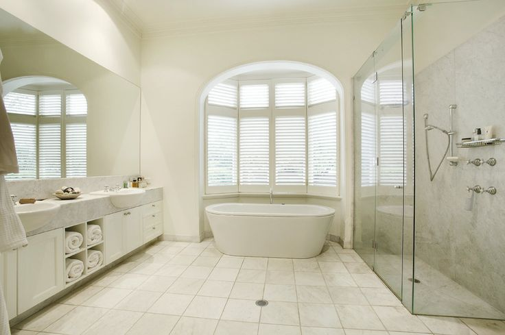 Bathroom, white finish, arched windows,   Constructed by Classic Projects