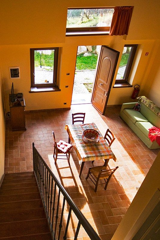 Located in Camporgiano, this holiday home features a terrace with garden views. Guests benefit from free WiFi and private parking available on site.
