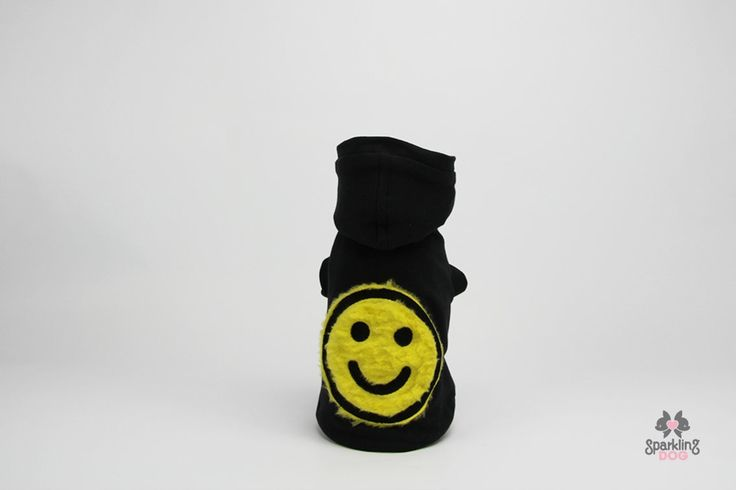 Black sweatshirt with enriched with fluo yellow big smile. Cap is removable.